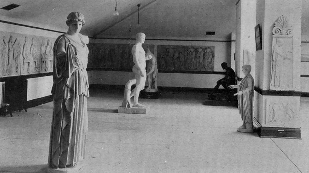 historical photo of a gallery with statues