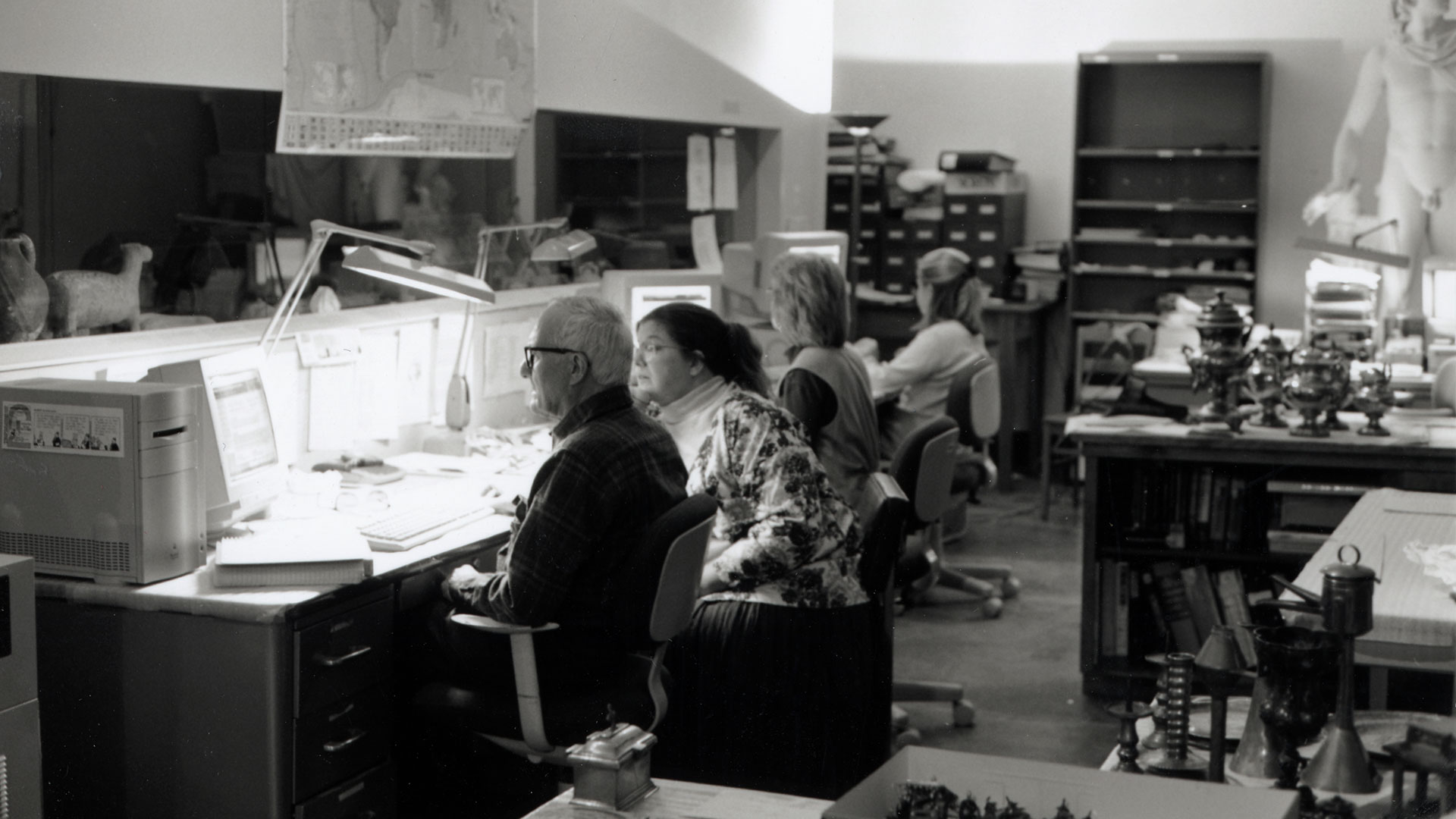 Black and white photo of staff working in gallery of Lincoln Hall ca. 1998