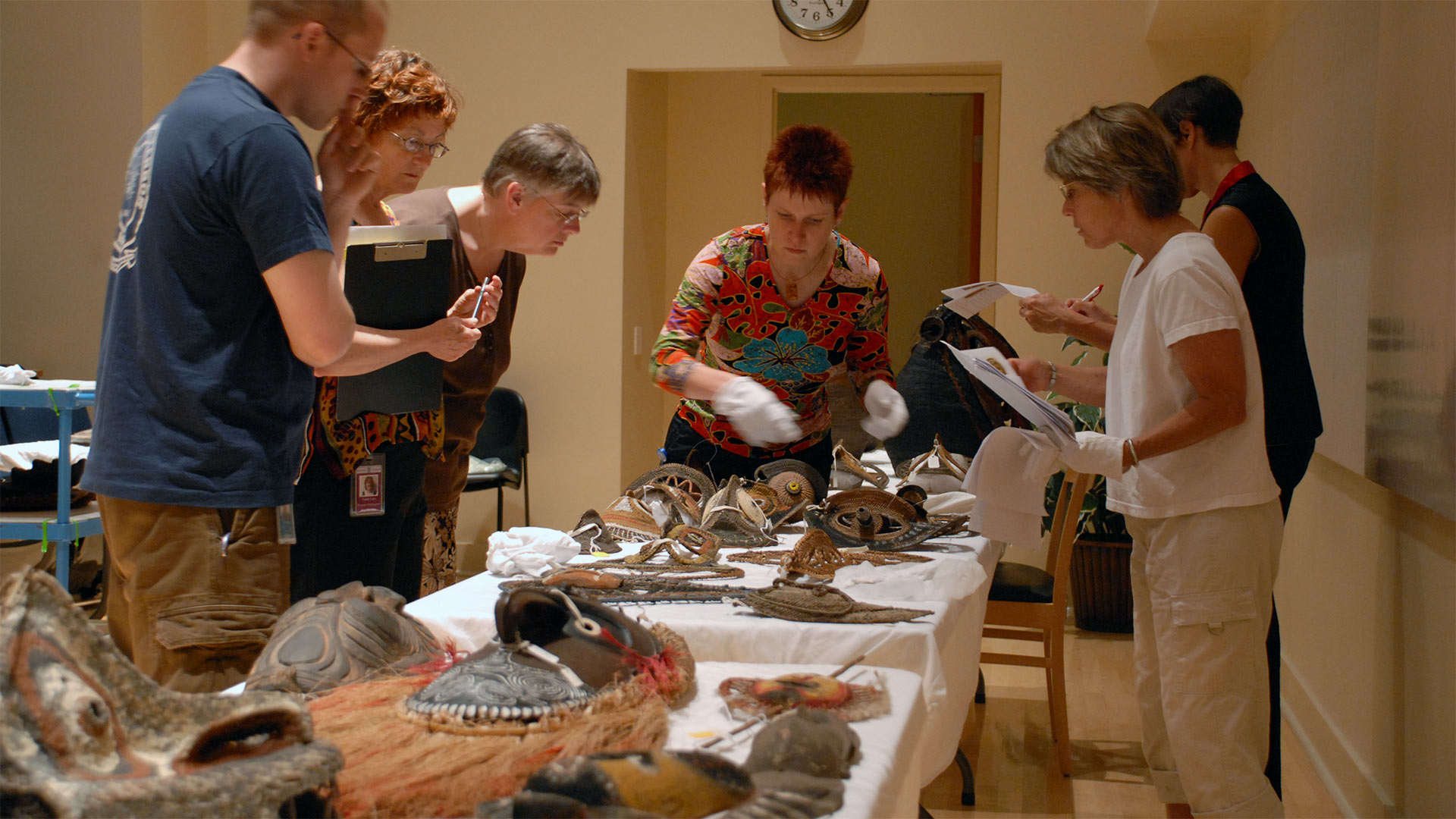 Museum staff reviewing Oceanic artifacts