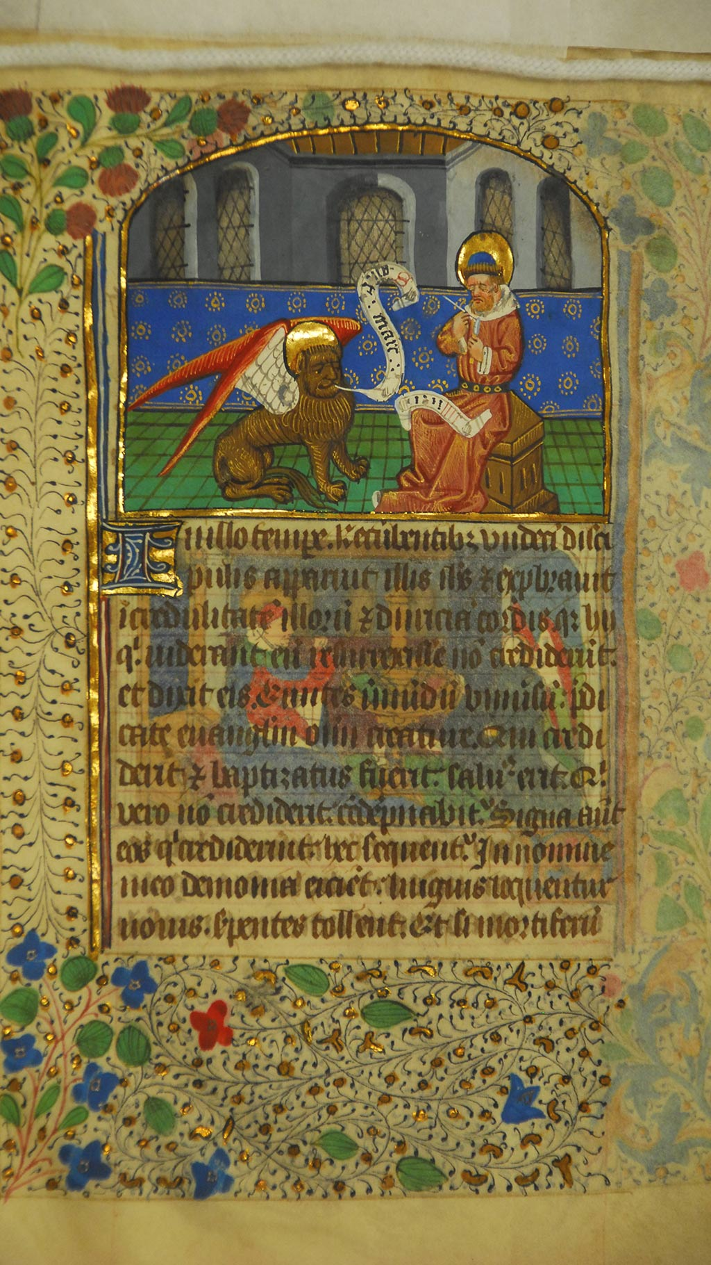 inside page of the manuscript,  man holding a pen, horse with wings, followed by a paragraph in Latin