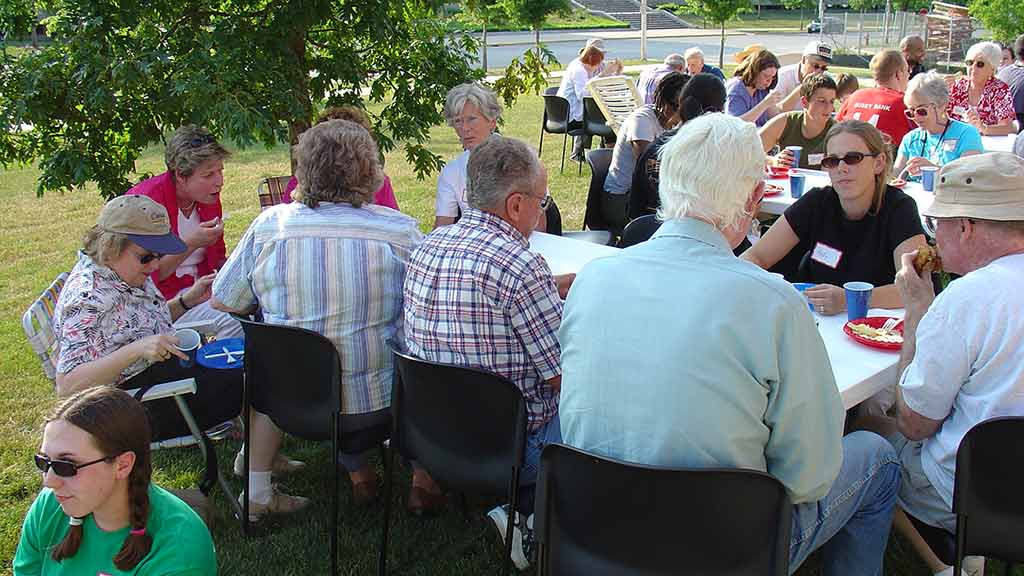 More than 50 volunteers, friends, and family braved the heat to join in the picnic.