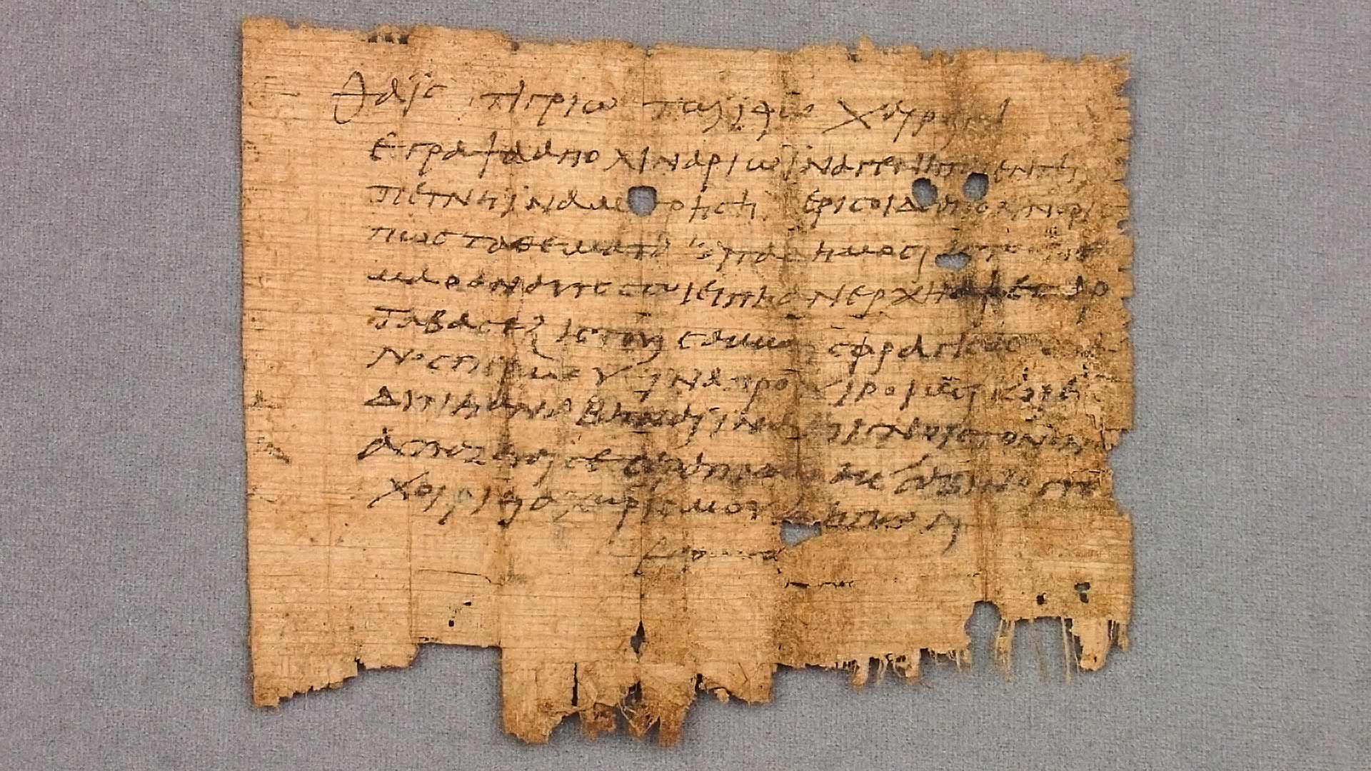papyrus page with legible writing; tattered bottom edge
