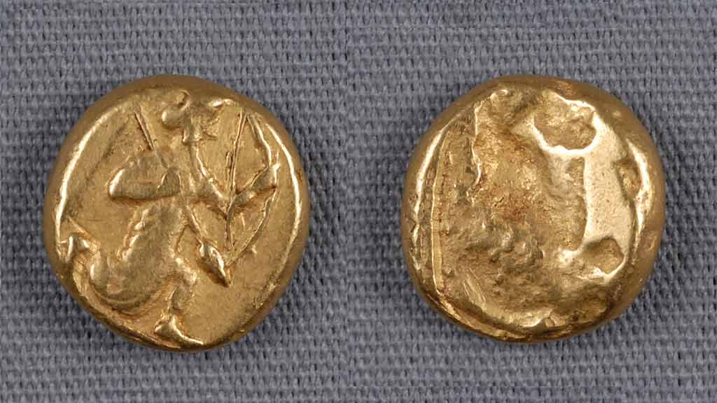 Front and back of a golden coin with rough designs of a hunter and animal