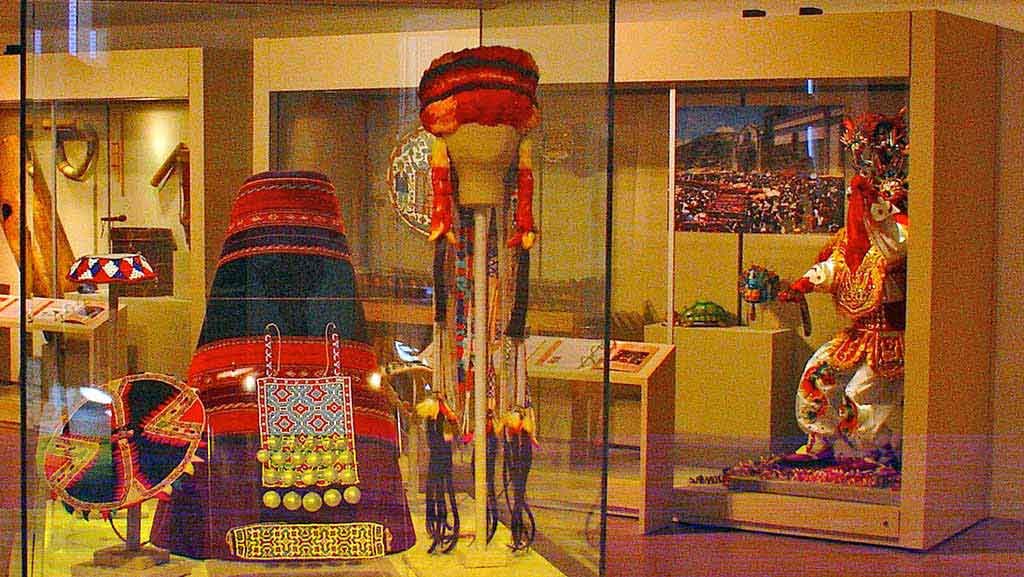 gallery view, red, yellow and purple headdress and costume