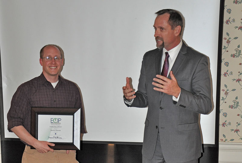 Assistant Collections Manager John Holton accepts our 2014 ECIP award from Facilities and Services Executive Director Allan M. Stratman.