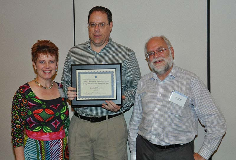 Collections Manager Christa Deacy-Quinn, UIUC Associate Director of Utilities and Energy Services Karl Helmink, and Museum Director Wayne Pitard with the 2013 ECIP award.