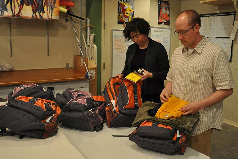"Museum staff ""first responders"" check materials in their personal backpacks."
