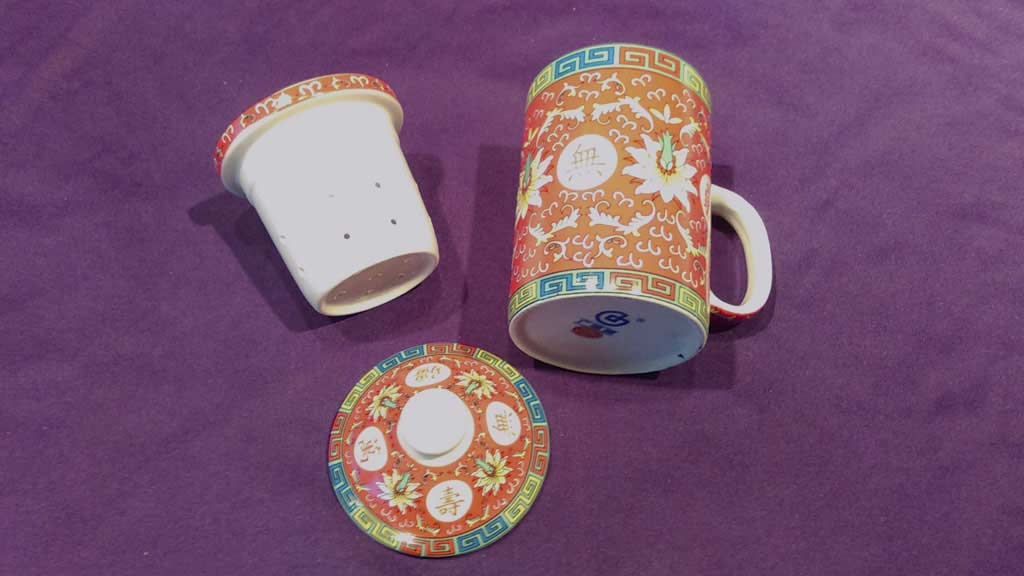 decorated mug and other porcelain item