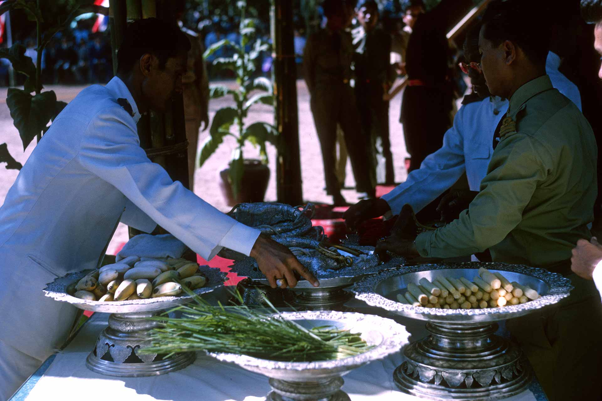 Military personnel prepare platters of food