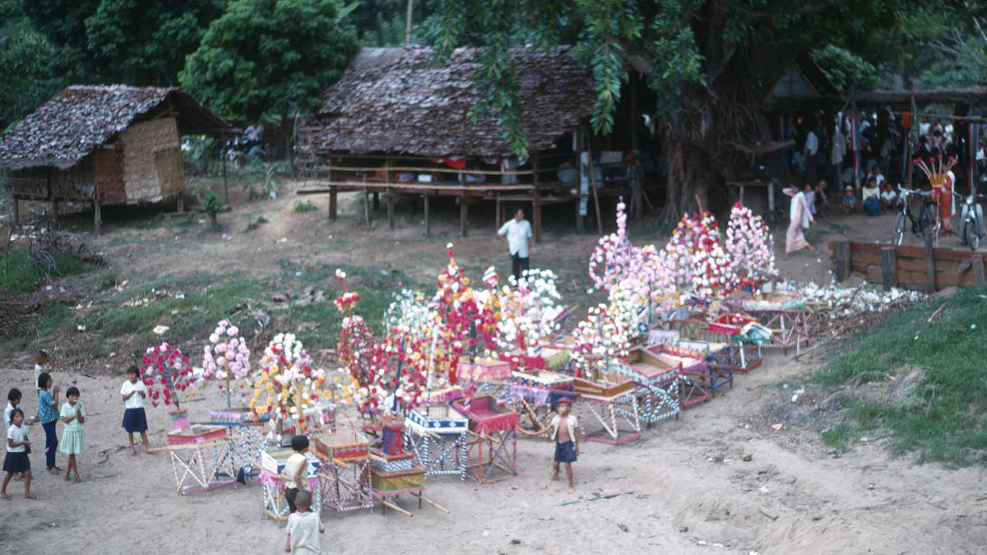 Dozens of processional float-like gifts line the beach