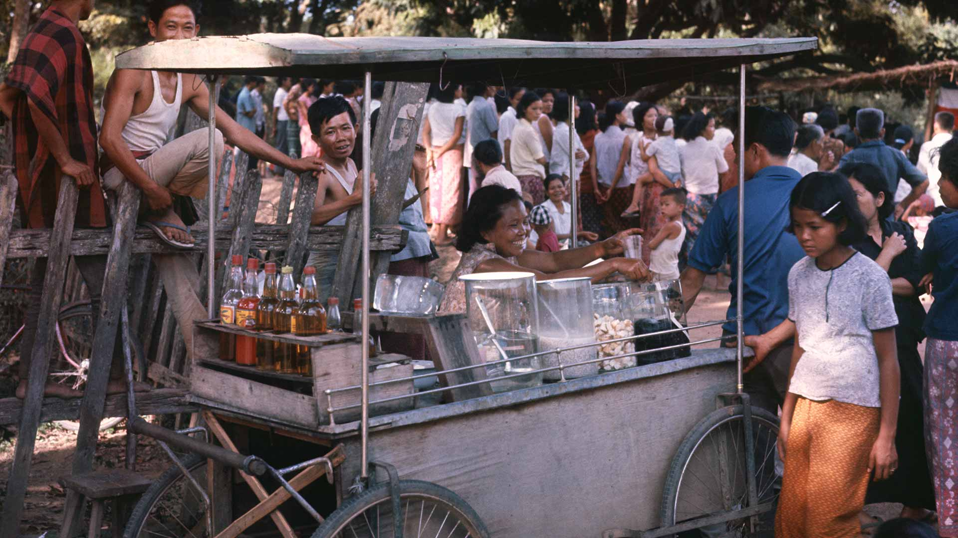 A food cart in a crowd of people