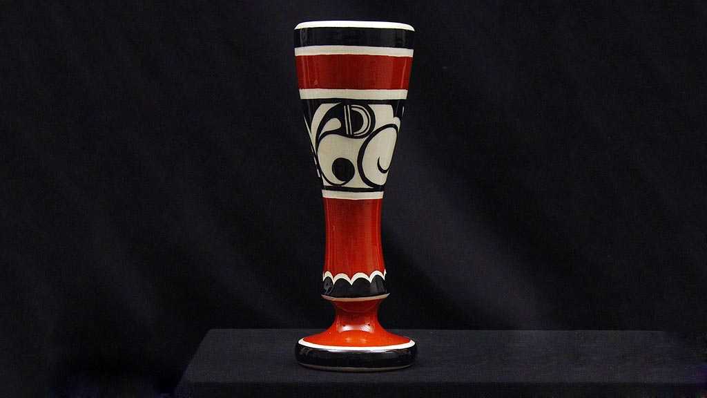 Narrow red, white, and black vase