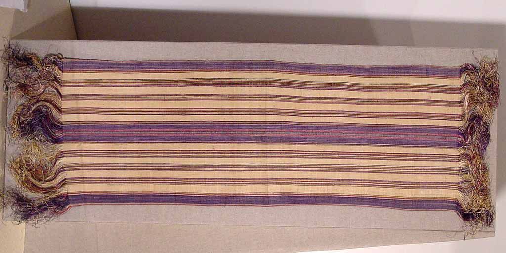 textile with tan and purple striped pattern and fringed ends
