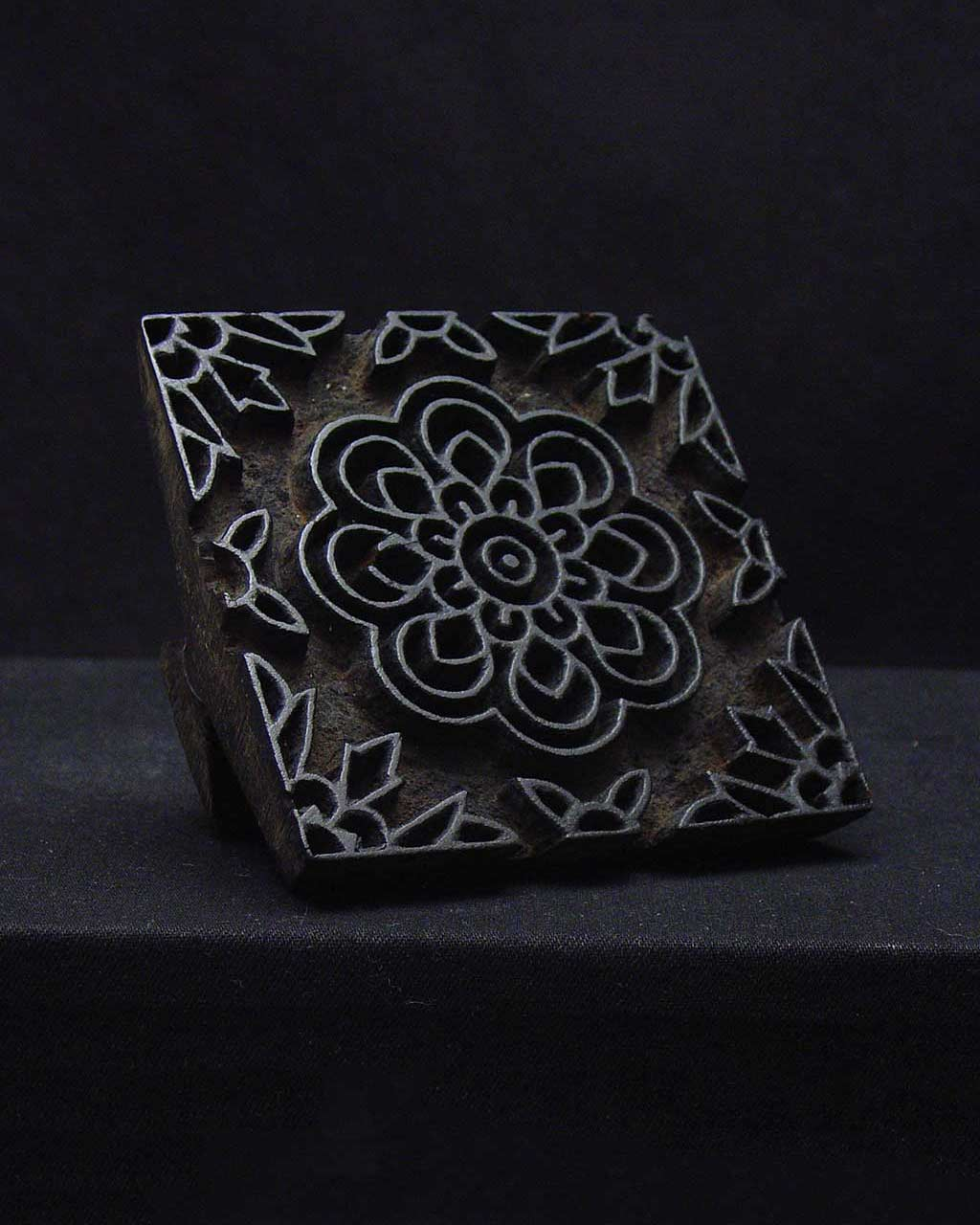 nearly square wooden block with floral pattern