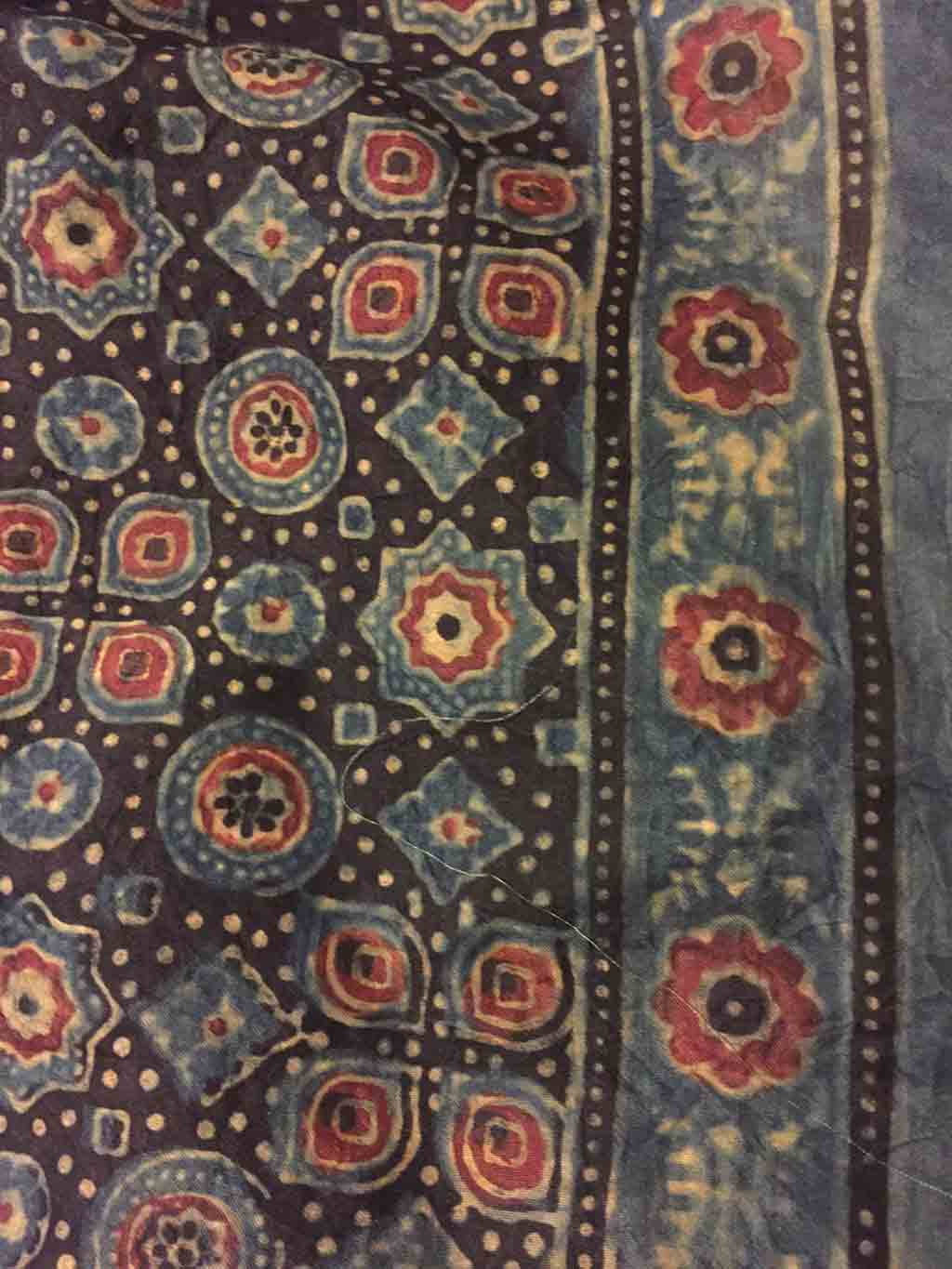close-up of small flowers and detail on rug