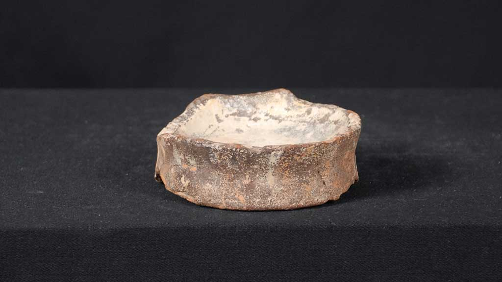 shallow concave stone dish