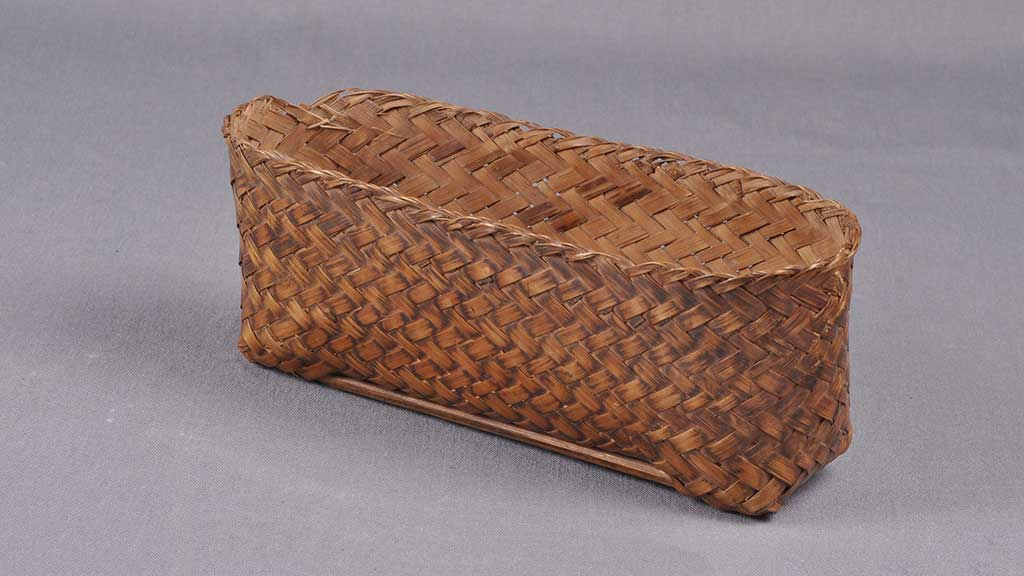 long and skinny tightly woven rigid basket