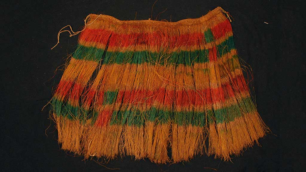 brown grass skirt with red and green bands