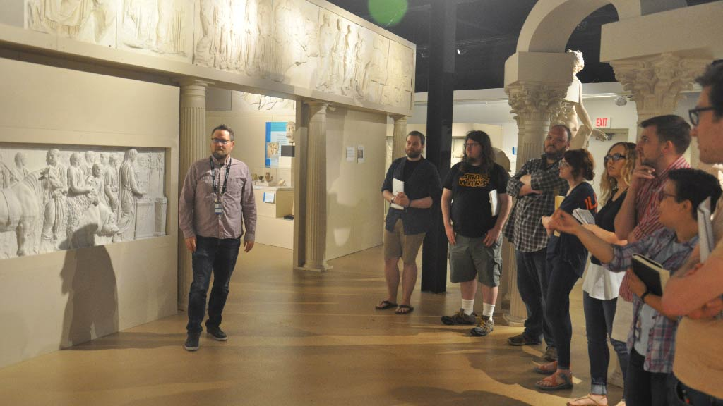 Guide leading a tour through the Spurlock Museum.