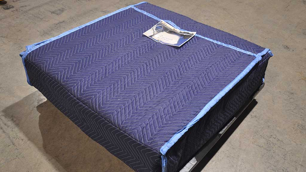 Box with blanket sewn by employee.
