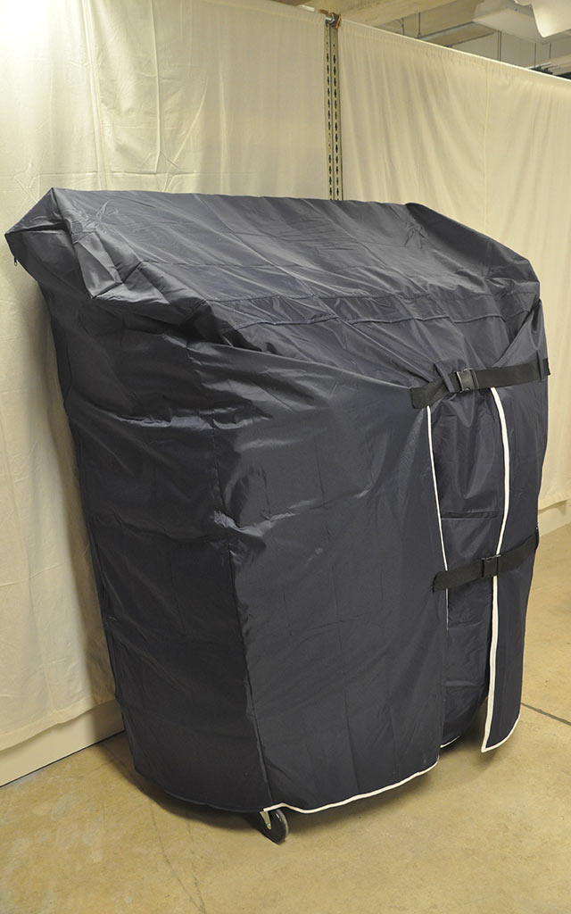 Clothing rack with cover.