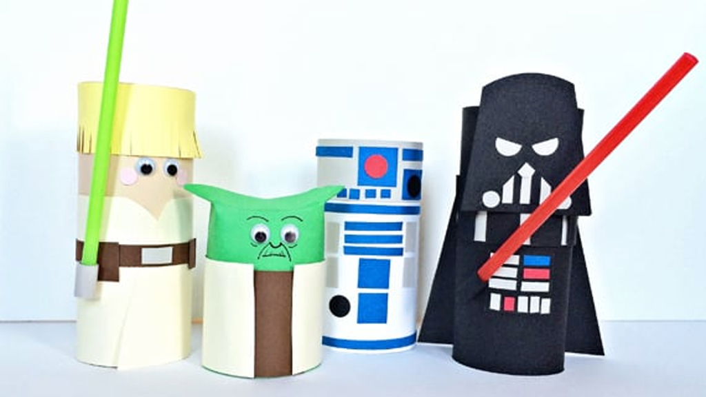 4 toilet paper rolls that have been made to look like Star Wars characters