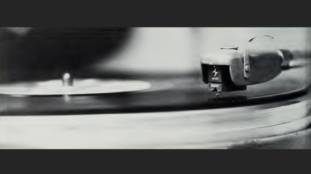 Black and white photo of a record player.