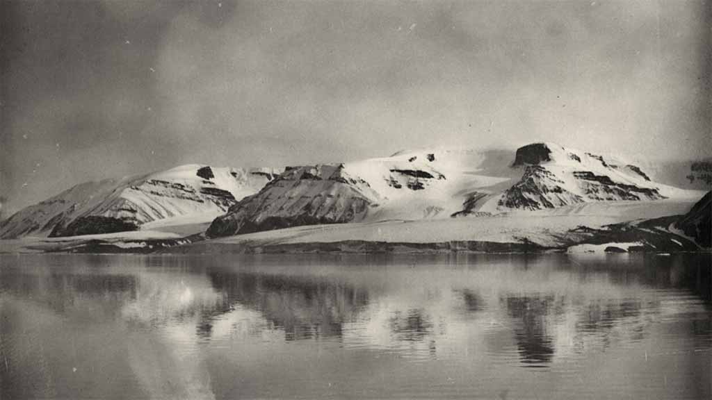 arctic landscape: mountain with reflection in water