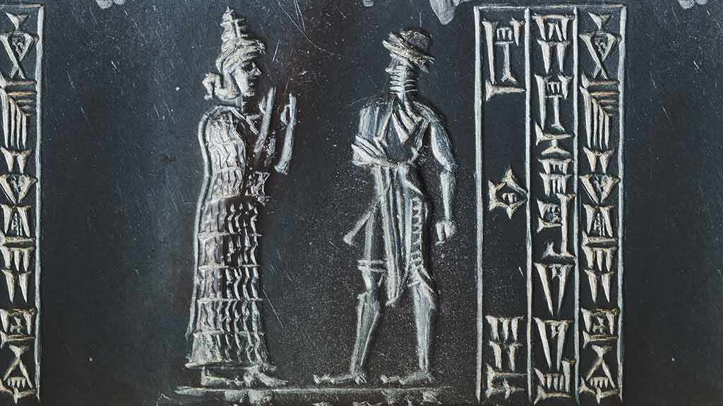 King and goddess with three columns of cuneiform
