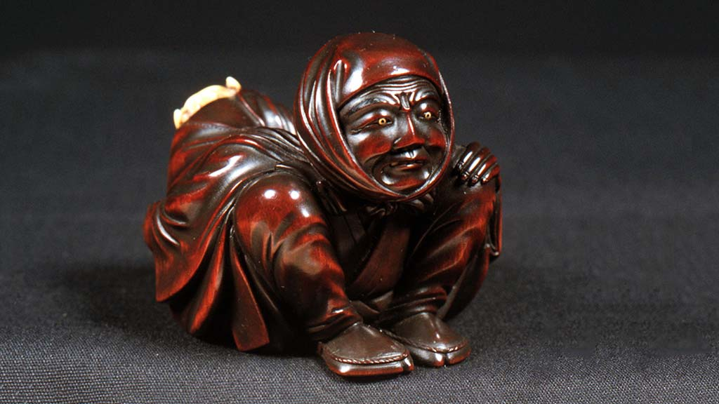 carved crouching figure