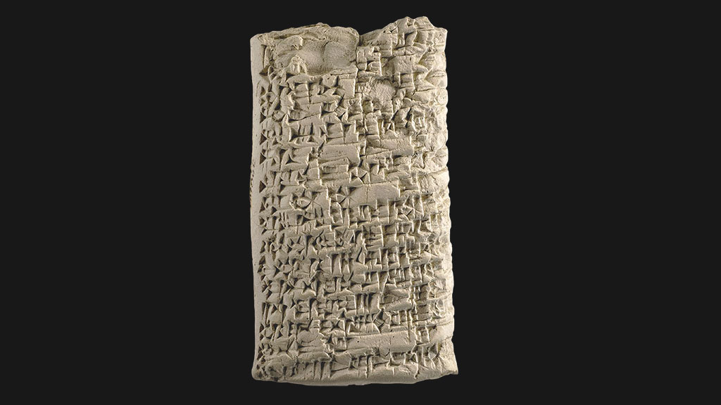 rectangular tablet with densely packed cuneiform across the surface