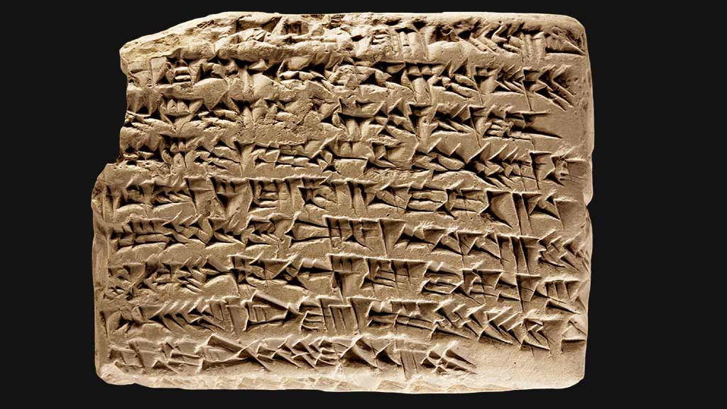 second rectangular tablet with densely packed cuneiform covering the surface