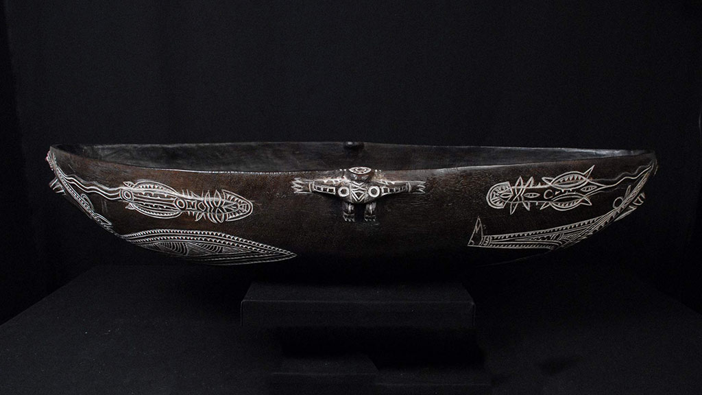 wooden bowl with white painted incised designs
