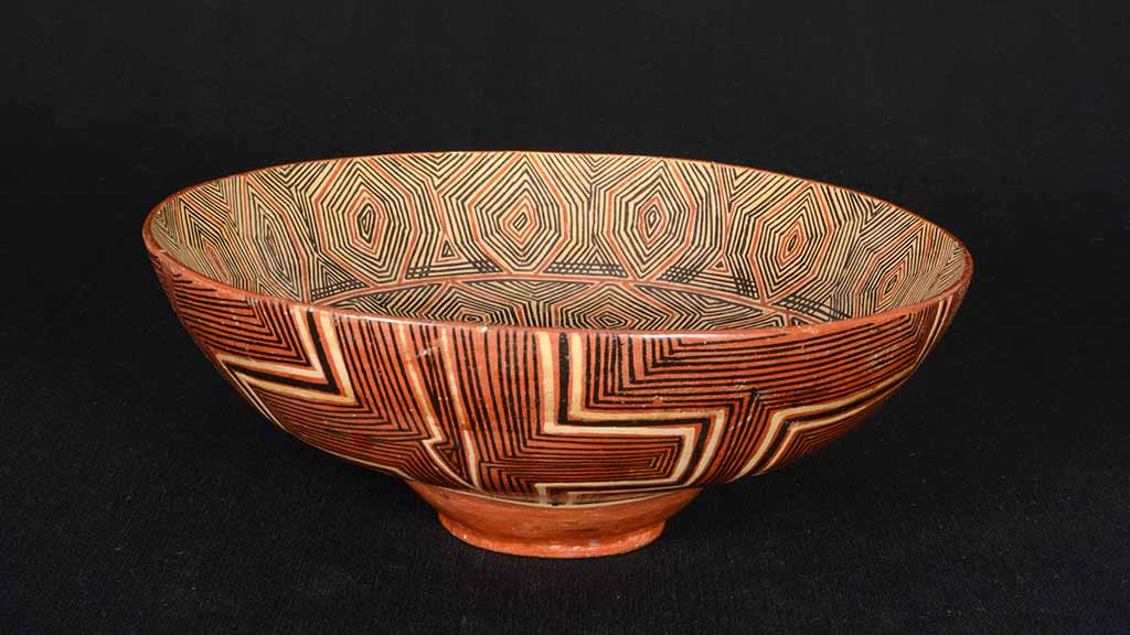 ceramic bowl with geometric patterns on both in the inside and outside