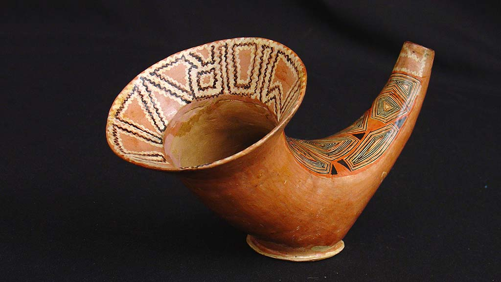 conical ceramic vessel with geometric designs
