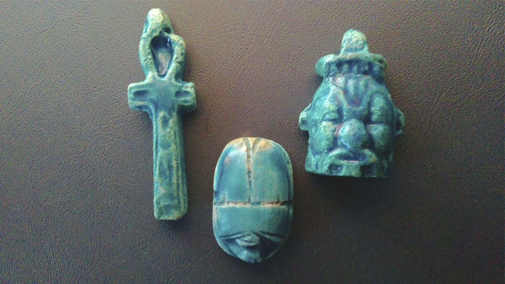 three amulets from the kit