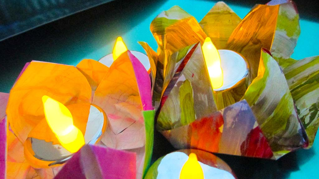 paper lotus flowers with tea light candles