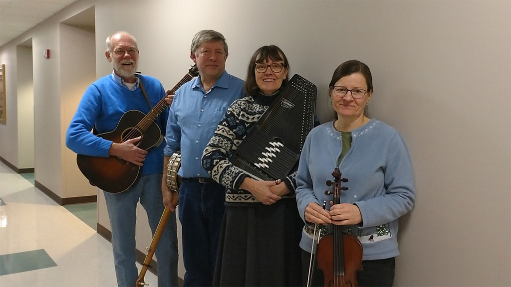 Quartet of 2 men and 2 women posing in a hallway with their old-time instruments 2/26/2017