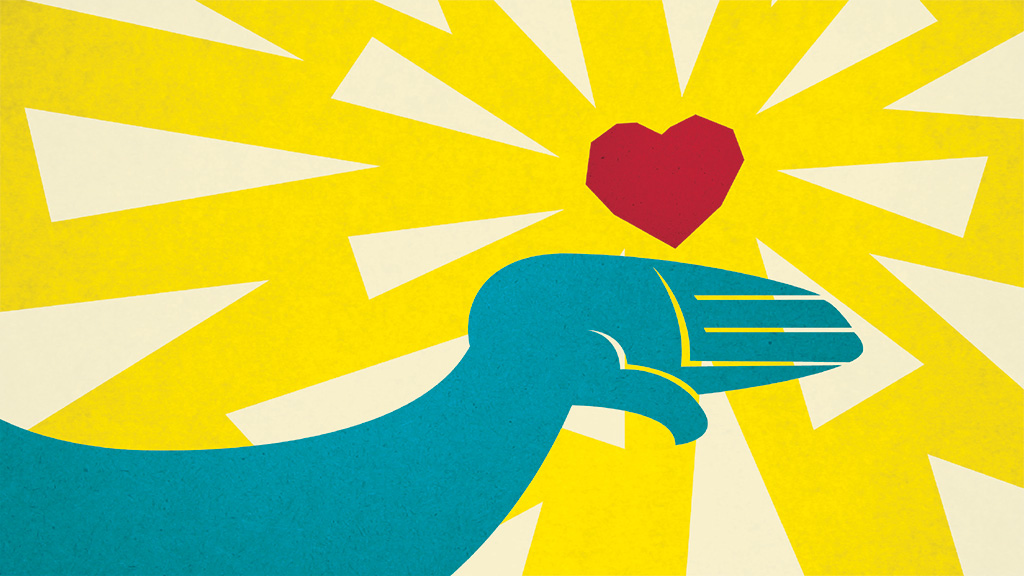 a hand holding a heart in yellow background