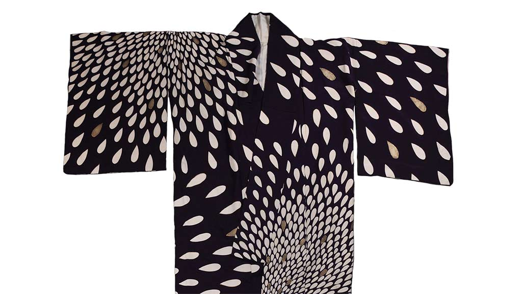 Japanese traditional clothing Kimono, black in color, populated with cream colored petals  3/27/2018