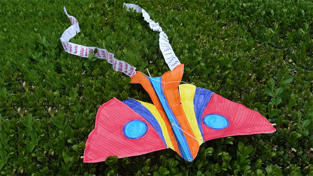 colorful bird kite with long white streamers 7/21/2019