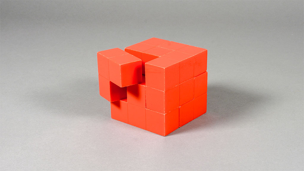 Red puzzle cube with one piece slightly askew