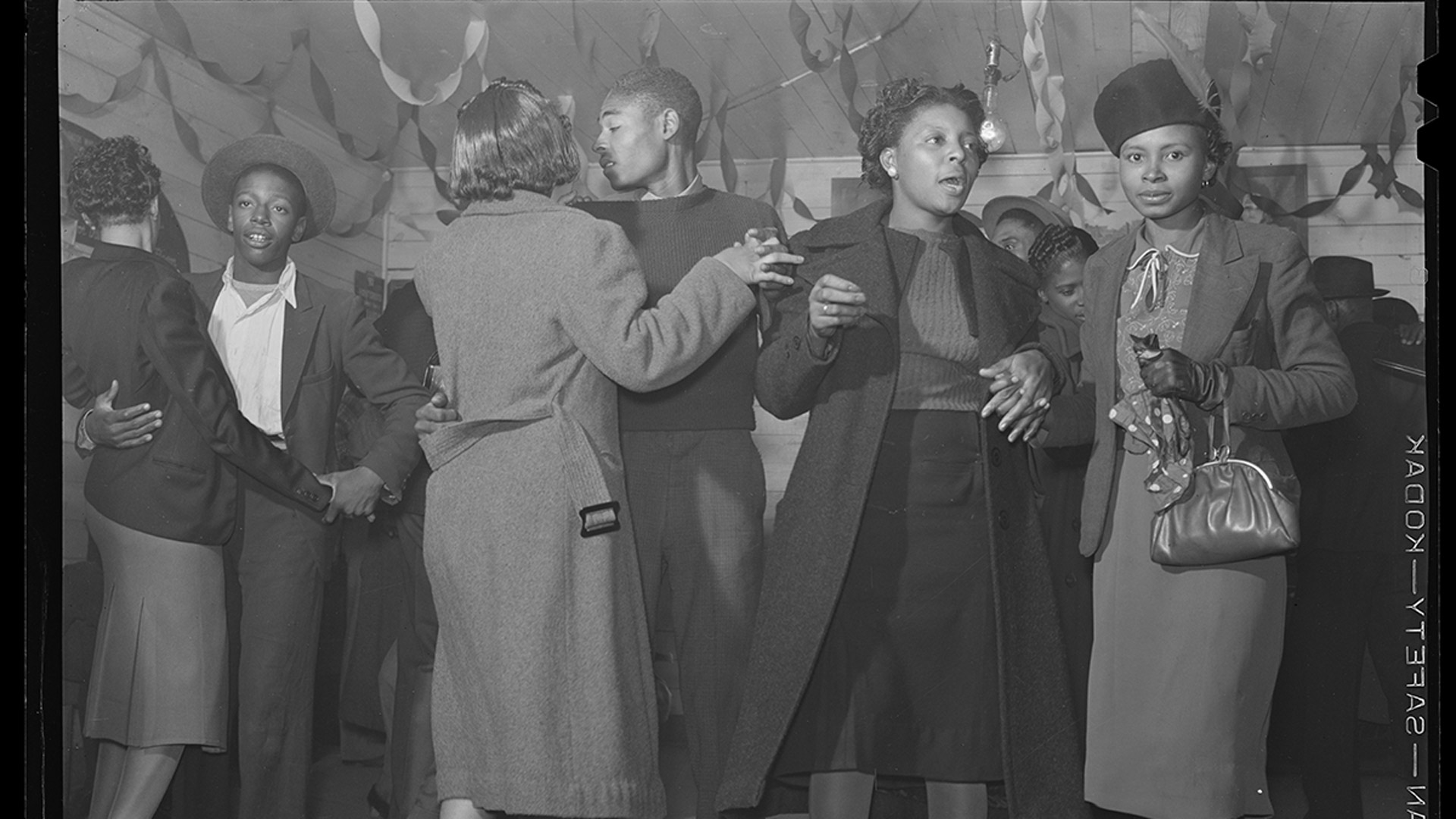 African American men and women dancing together.