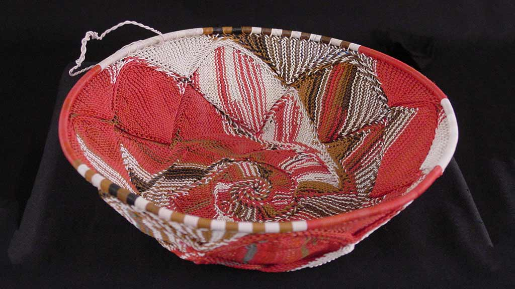 bowl-shaped tightly woven red and white basket