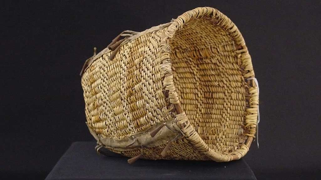 wide-mouthed basket with subtle bands of different colors of reed