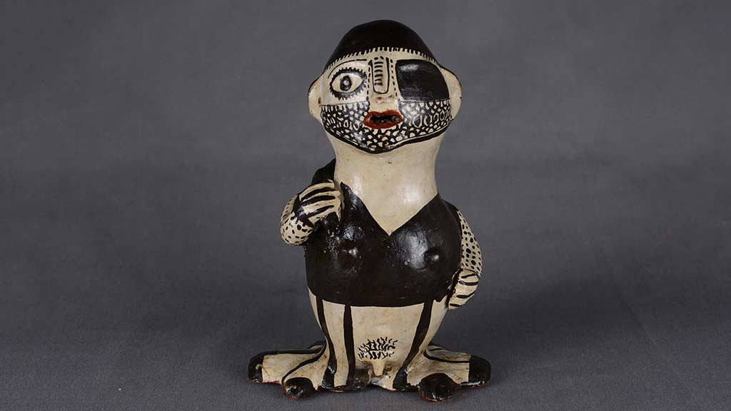 black and white ceramic figure with beard stubble and an eye patch