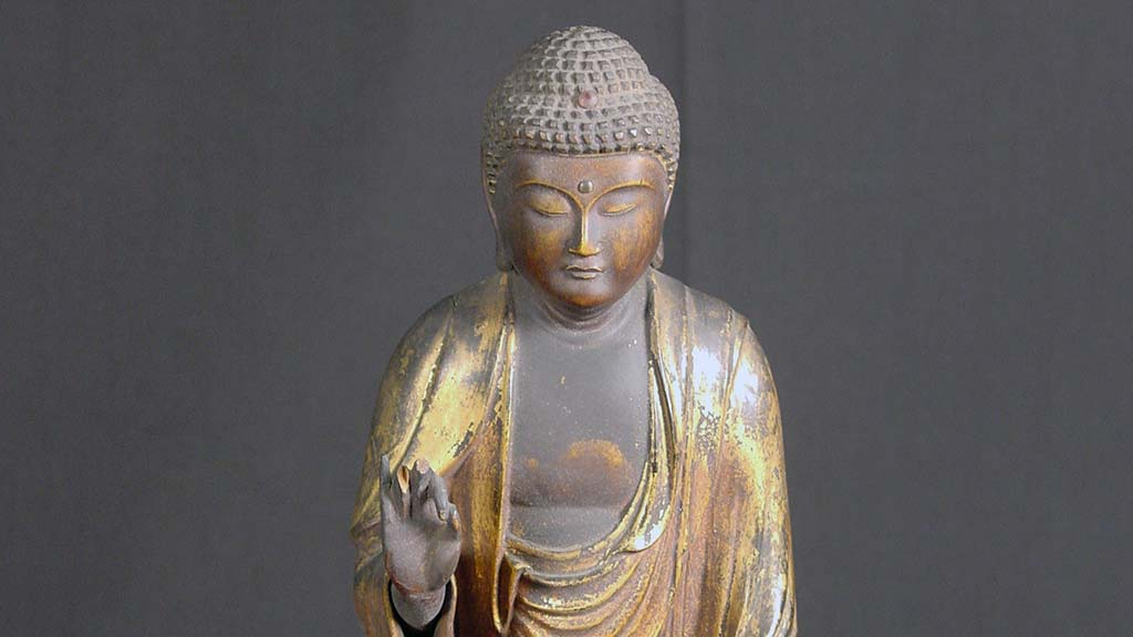gold and gray buddha