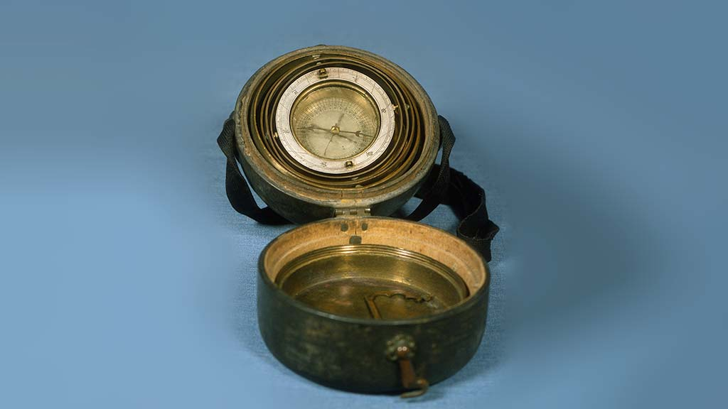 compass with a flipped open lid