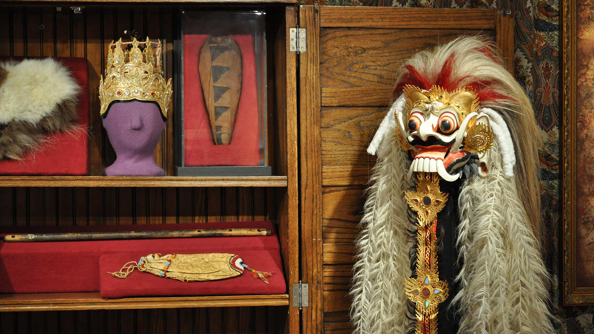 head mask, crown, fur, wooden object and fringe