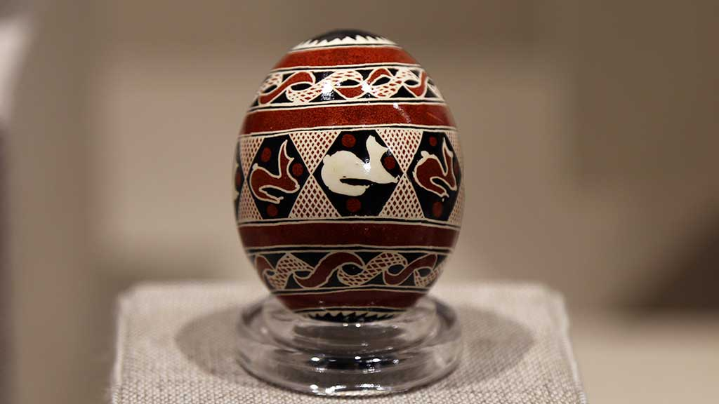 decorated egg with brown, black, and white abstract designs